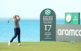 Graeme McDowell holds nerve in 'brutal' conditions to take one shot lead into final round at Saudi International