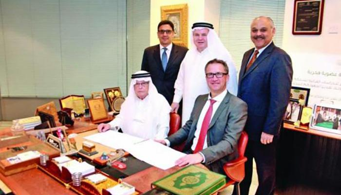 Jan Van der Goten, general supervisor of Janssen for GCC countries, and Dr. Walid Amin Al-Kayali, CEO of the Medical and Cosmetic Products Company, with other executives at the signing of the agreement in Riyadh.