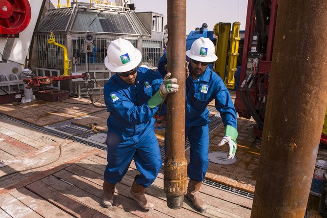 Workers at an Aramco onshore rig. Saudi Arabia exported nearly 11 million barrels of oil per day in
